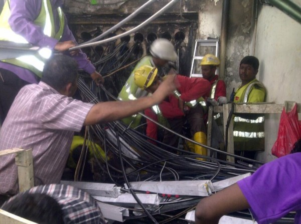 SingTel workers restoring fibre optic network
