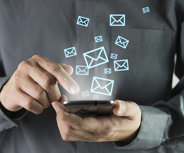 Concept of sending message wireless using smartphone. Source: iStockphoto