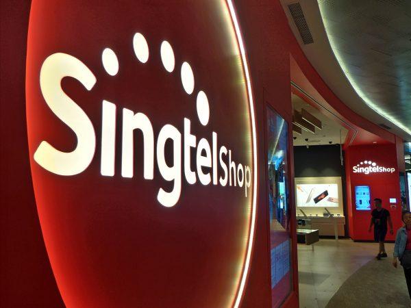 Singtel logo outside a Singtel retail shop in Singapore. PHOTO: Wilson Wong for Techgoondu