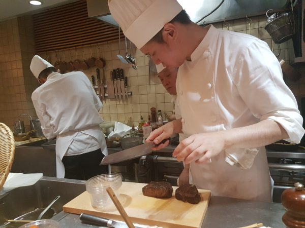 A chef preparing a steak at the highly-regarded Shima restaurant near Tokyo station. PHOTO: Alfred Siew